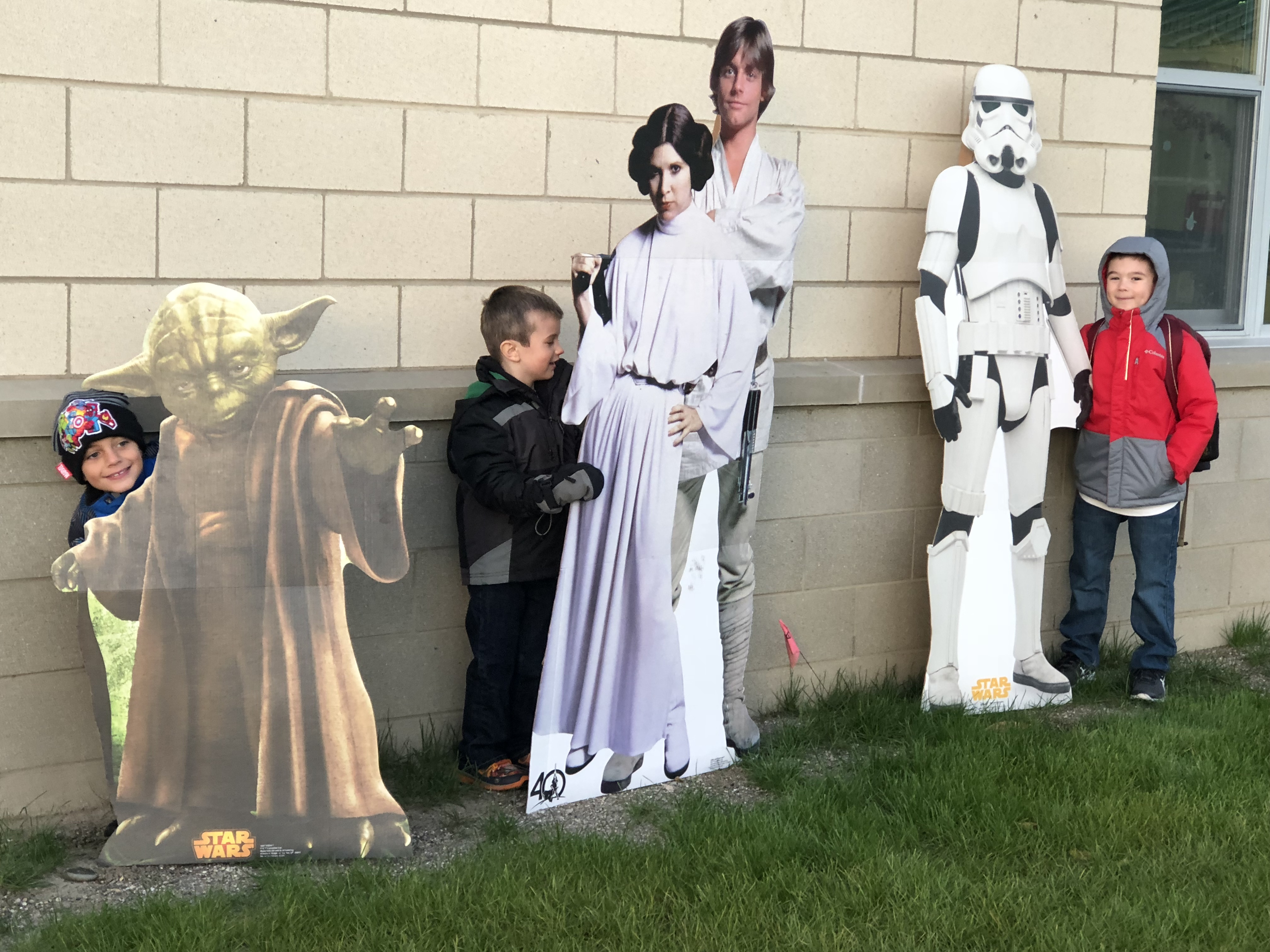 Kids standing with Star Wars characters